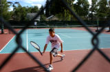 (DENVER, CO., AUGUST 27, 2004) Zeke Munoz, 14, of North High School, plays a home game against...