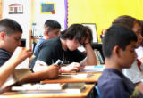 (DENVER, CO., AUGUST 26, 2004) Denny Serna, 17, (center) reads in Mrs. Louise West's Intro to...