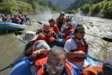DLM1301  Lee Tom Jones, 25, center, smiles from ear to ear as he floats down the Colorado River...