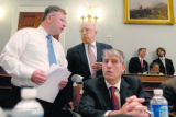 Rep. Doug Lamborn, R-Colo., left, confers with Rep. Mark Udall, D-Colo., right and senior...