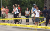Students stand behind police lines as Boulder Police and their bomb unit responding to a stabbing...