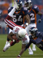 (DENVER, Colorado. September 2, 2004)  Cardinals reciever #86 Karl Williams is tackled by Broncos...