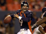 (DENVER, Colorado. September 2, 2004)   Bradley Van Pelt passes on his TD drive in the 4th quarter...