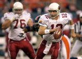 (DENVER, Colorado. September 2, 2004)   QB Jeff Shoate runs for a gain in the 1st quarter        ...