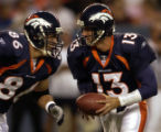 (DENVER, Colorado. September 2, 2004)  QB Danny Kannell hands off to 86 Patrick Hape in the 1st...