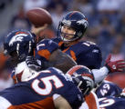 (DENVER, Colorado. September 2, 2004)  Broncos quarterback #13-Danny Kannell is pressured to throw...