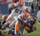WEB CAPTION - Denver Broncos running back Cecil Sapp is brought down by Cleveland Brown defenders...