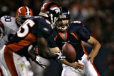 Denver Broncos quarterback Patrick Ramsey (8) pitches the ball to running back Selvin Young (35)...