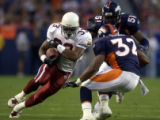 (DENVER, Colorado. September 2, 2004)    Running back Josh Scobey runs for a gain as he is about...