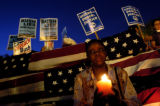 (9/03/2004) New York City-Yolanda Dickerson, Brooklyn, burns a candle in Union Square Park...