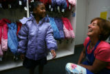 Milahni Wilkerson, 5, (cq) spins happily in her new winter coat in her favorite color purple while...