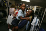 Milahni Wilkerson,5, happy being held by her cousin Nashea Rice, 10, (cq both) after they had...