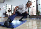 Eddie Owada (cq) 81, is always smiling as he leads his students, all senior citizens, through...