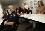 Transgender Aurora Police Det. Renee Grahn (cq), far right, sits in on the morning briefing in the...
