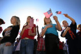 Holding small American flags students- first graders who were babies in 2001 - the 9/11 disaster...