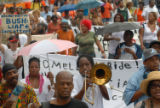 (NYT15) NEW ORLEANS, La. -- Aug. 29, 2007 -- KATRINA-ANNIVERSARY-2 -- Demonstrators march from the...