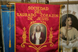 Processional banners sit inside St. CajetanCatholic Church in Denver.  Father James Prohens, C.R....