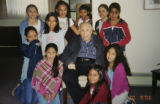 Father James Prohens, C.R. (cq) is pictured with children in the C.C.D. class at St. Cajetan...