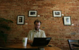 Tim Marham (cq) of Denver works on his lap top at Hooked on Colfax coffee shop on Colfax Ave., in...