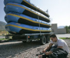 DLM1298  Iraq War Army veteran Alfredo Capps gets ready to go rafting next to a stack of boats on...