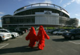 Broncos fans Kerry Green (cq), left, 50, and his son Wesley Green (cq), 21, walk through the...