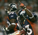 Denver Bronco's running back Andre Hall runs off the field in the second quarter of the Bronco's...