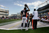 Denver Bronco's second year quarterback Jay Cutler stands   sideline before the Bronco's last...