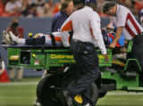 Denver Bronco's corner back Karl Paymah is put on a stretcher and carted off the field in the...