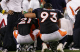 JPM474 - Denver Broncos Antwon Burton, #93, consoles Broncos safety Hamza Abdullah as they watch...