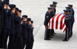 Honor Guard carries the casket into the funeral service for PFC Dane Balcon (cq) at the Air Force...