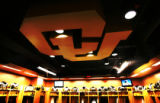 A interlocking wood CU emblem hangs from the ceiling of locker room of the new $1 million locker...