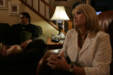 DLM1823  Deana, right, and Mike Mobley listen to President Bush's televised address to the nation...