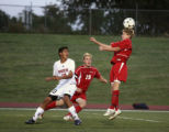 Rangeview midfielder Jorge Sanchez watches as Heritage midfielder Travis Sytsma tackles the ball...