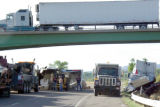 A tractor trailer passes over the 20 Road overpass on I-70 after a truck accident closed down...