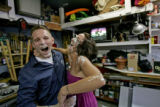 Twenty-four-year-old Brad Adams, left, holds older sister April Adams, 29, left,  as the get in a...