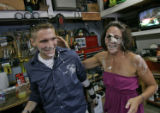 Twenty-four-year-old Brad Adams, left, holds older sister April Adams, 29, left,  after a birthday...