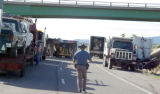 Colorado State Patrol trooper Jim Womack walks I-70 where a truck accident closed down eastbound...