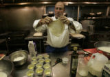 Frank Bonanno (cq) flattens out a piece of mozzarella cheese that he made from mozzarella whey in...