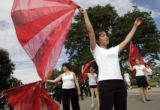 Monarch Color Guard member Stephanie Tsen (cq), 17, twirls her red flag just before the beginning...