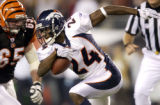 (JACKSONVILLE, FLA., SEPTEMBER 19, 2004) - Denver Broncos' #80, Rod Smith, center, is tackled by...