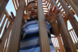Arturo Villalobos, (from mom) carefully makes his way along the inside of the new tree house. The...