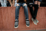 Ripped jeans a staple of clothing for Stasha Saunders (CQ), 13, of Aurora, Colo., as she waited...