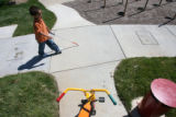 Uriah Henry, (cq), learns to walk with his cane on the new braille circle where each alphabet...