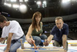 (from left) Dusty Powell (cq), Jami Haber (cq) and Dan Jacobs (cq) join a team of volunteers,...