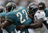 (JACKSONVILLE, FLA., SEPTEMBER 19, 2004) - Denver Broncos' #98, Reggie Hayward, right, tackles...
