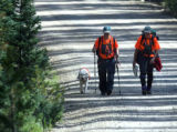 L to R: Rosie (cq) a yellow lab search dog along with Allen Weaver (cq) and Robyn Bond (cq) of ...