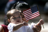Leah Porter (cq) holds her baby Julianna, 10 months, after she was sworn in as a citizen in Denver...
