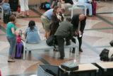 Travelers make there way through DIA checkpoints September 5, 2007. Thefts are up at DIA -- and...