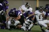 (JPM307) -  No. 3-ranked Douglas County Huskies running back Ryan Misare, #43, lunges for extra...