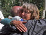 Marion Jones (cq)  ,right, hugs ha friend after making it out to the  Big South Trailhead ...